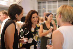 ladies chatting wine